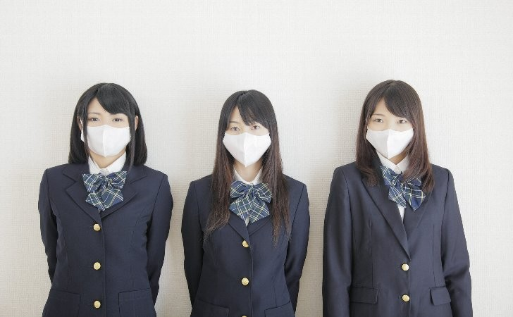 image of students who are tyring to avoid cathing a cold in the important season